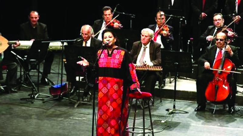 74-year-old Salwa al-Aas, a Jordanian vocalist of Palestinian origin, performs with the Beit al-Rowwad ensemble at Amman's Hussein Cultural Center on March 20.  (Photo:  AFP)