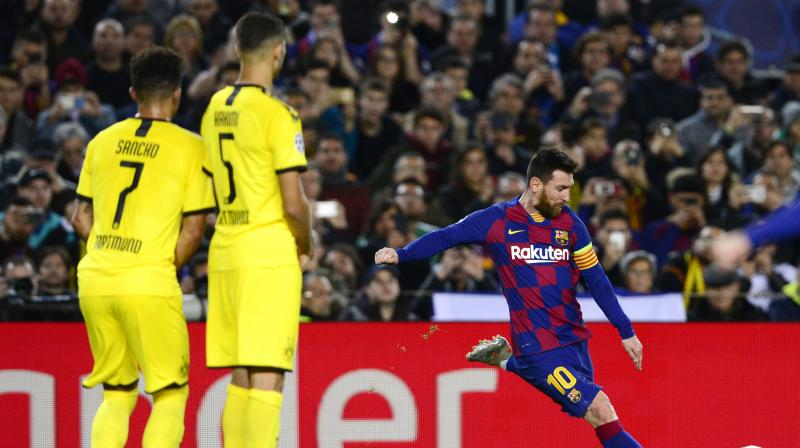 Lionel Messi scored in his 700th match for Barcelona and also set up goals for Luis Suarez and Antoine Griezmann as the Catalans beat Borussia Dortmund 3-1 on Wednesday to seal a spot in the Champions League knockout stages as Group F winners. (Photo:AFP)