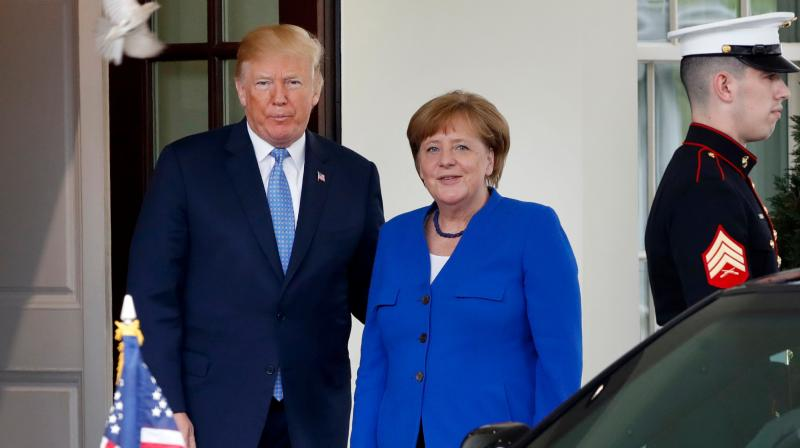 President Donald Trump shakes hands with German Chancellor Angela Merkel at the end of their news conference in the East Room of the White House, Friday. (Photo: AP)