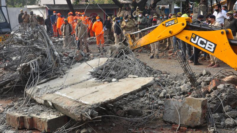 Rescue operation carried out by NDRF personnel after the complex roof of a crematorium collapsed due to heavy rain, at Muradnagar in Ghaziabad, Sunday, Jan. 03, 2021.(PTI)