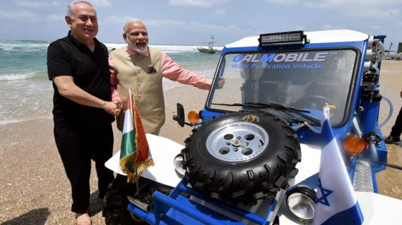 Israeli PM Netanyahu and PM Modi waded into the Mediterranean Sea and rode the 'buggy' jeep on the coast during the latter's visit to Israel in July 2017. (Photo: @narendramodi)