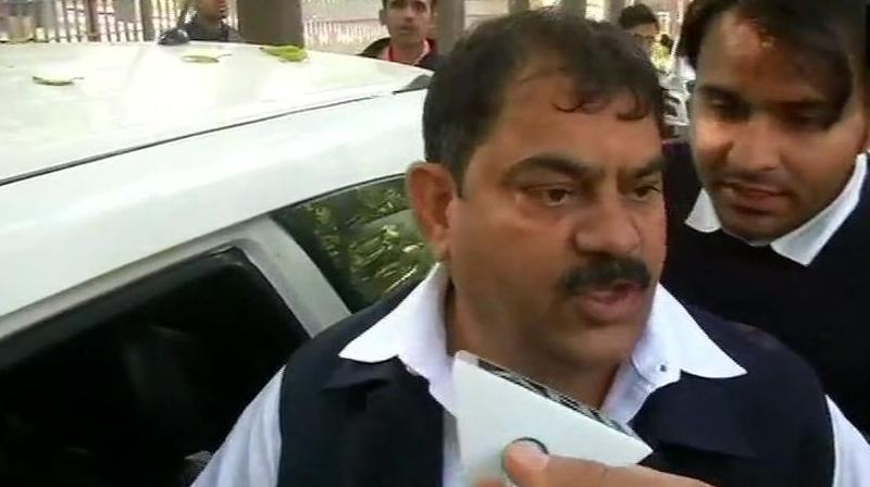 'Searches are on at my residence. What will they get when there is nothing. They are taking me to ED office for questioning,' Congress worker Jagdish Sharma told ANI. (Photo: ANI)