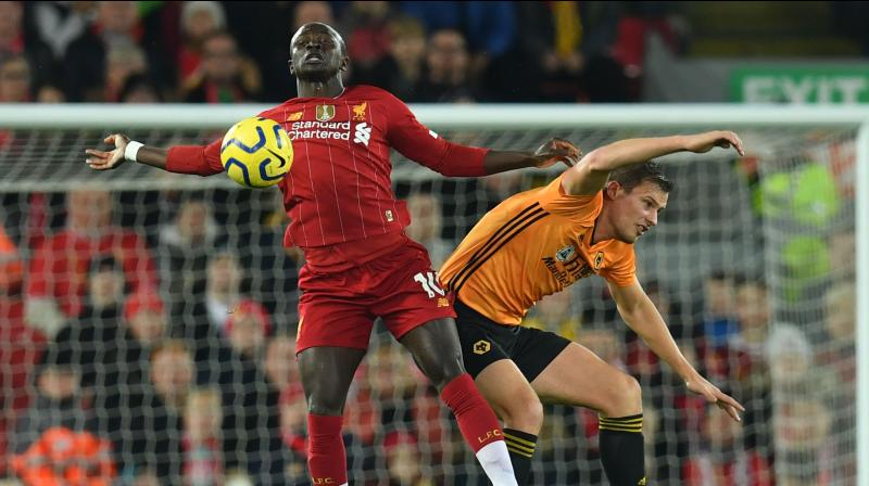 A controversial Sadio Mane goal was enough for Premier League leaders Liverpool to secure a nervy 1-0 victory over Wolverhampton Wanderers and open up a 13-point cushion over their nearest challengers on Sunday. (Photo:AFP)