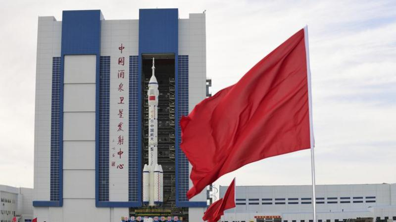 In this photo released by Xinhua News Agency, the Shenzhou-12 manned spaceship with its Long March-2F carrier rocket is being transferred to the launching area of Jiuquan Satellite Launch Center in northwestern China's Gansu province, on Wednesday. (Photo: AP)