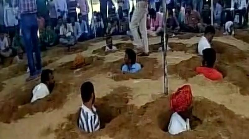 The farmers performing 'Samadhi Satyagraha' said, 'If the government takes our land, they will take away our lives.' (Photo: ANI | Twitter)