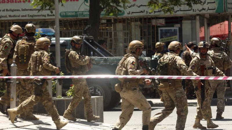There were conflicting reports of casualties as the attack unfolded, with a witness at the scene saying he saw bodies of at least two policemen lying on the road outside the embassy soon after the attack began. (Photo: AP)
