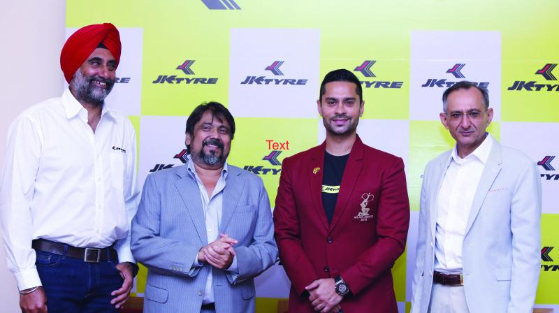 Gaurav Gill (second right) at a function to announce plans for the FIA World Rally Championship 2 with JK Tyre officials in New Delhi on Friday.