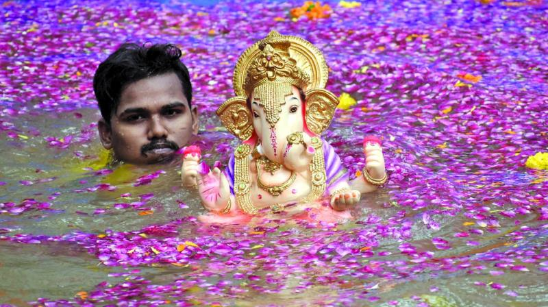There are 69 natural spots (beaches, lakes, wells) and 32 artificial ponds for immersing the idols across the city.