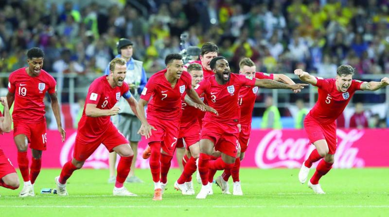 English players celebrate after beating Colombia on penalties at the Spartak Stadium in Moscow.	 (Photo: AP)