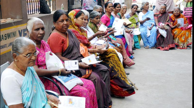 Hyderabad: Senior citizens in a queue in front of a bank waiting for the bank to open so that they can withdraw their pension. (Deccan Chronicle Photo)