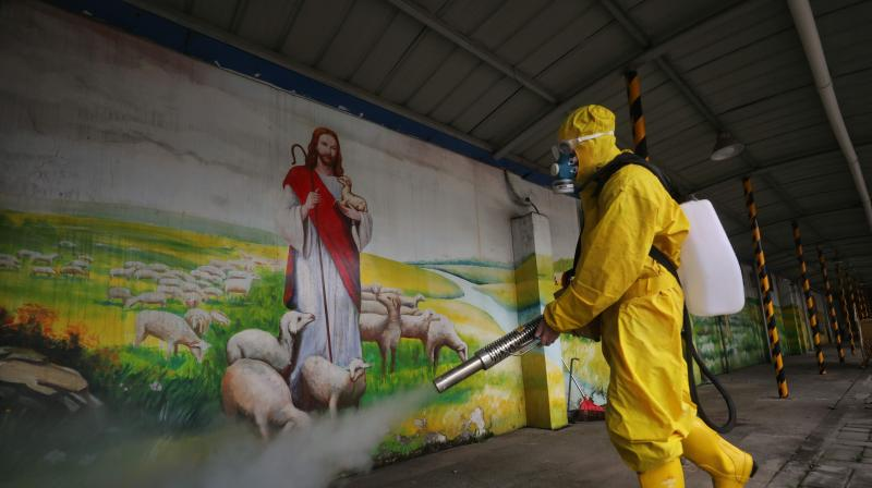 A worker disinfects the Hankou Salvation Church in Wuhan, in Chinas central Hubei province (AFP)