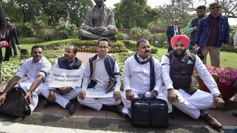 Suspended Congress MPs Gaurav Gogoi (C), T N Prathapan (2L), Dean Kuriakose (R), Manicka Tagore (2R) and Gurjeet Singh Aujla (R) stage a protest at Parliament during the ongoing Budget Session, in New Delhi (PTI)