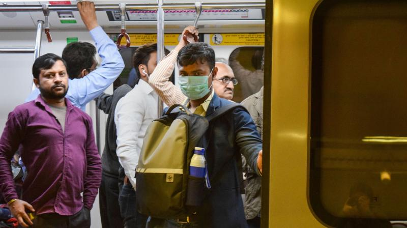 Passenger travelling in a crowded metro wears a face mask in wake of the recent coronavirus cases in India (PTI)