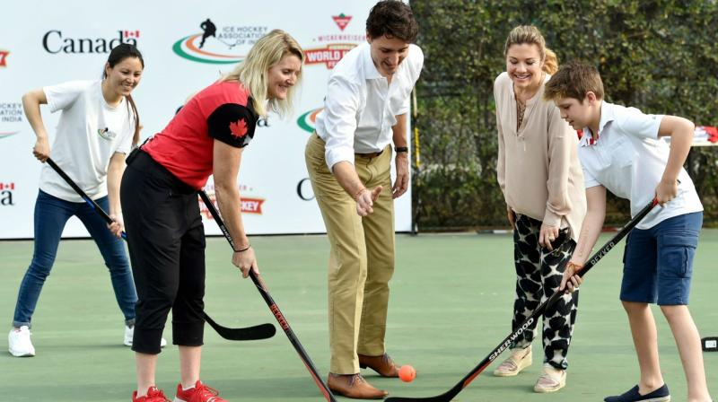 Canadian Prime Minister Justin Trudeau, First Lady Sophie Gregoire Trudeau, their son Xavier and Canadian ice hockey player Hayley Wickenheiser pose with ice hockey stick (PTI)