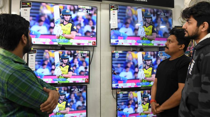 Cricket fans watchthe live broadcast of thewomens World Cup cricket final Twenty20 match  between Australia and India in an electronics shop (AFP)