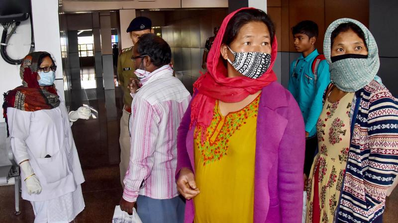 A medic checks passengers wearing masks in the wake of novel coronavirus scare (PTI)