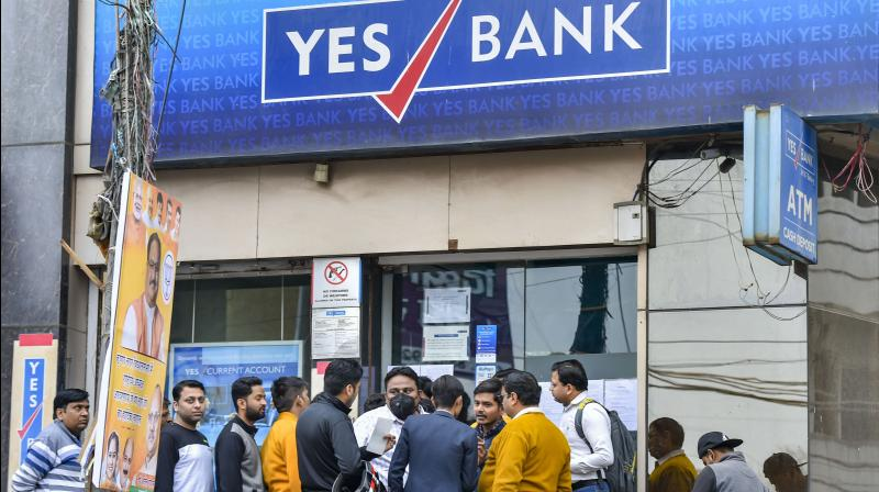 Account holders stand in a queue to withdraw money from YES Bank (PTI)