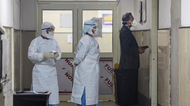 Medics wearing protective masks inside the novel coronavirus isolation ward of Government Medical College Hospital in Jammu (PTI)