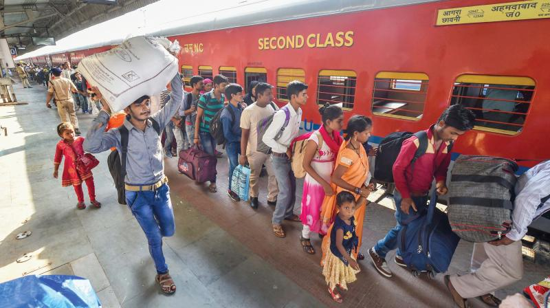 Migrant workers board a train in Ahmedabad on Tuesday in view of protests and violence breaking out over the alleged rape of a 14-month-old girl in Sabarkantha district. (Photo: PTI)