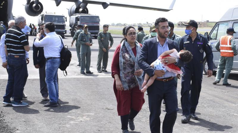 An Indian embassy staff member with his family arrives at Air force base, in Jamnagar. (Representational Photo:AP)
