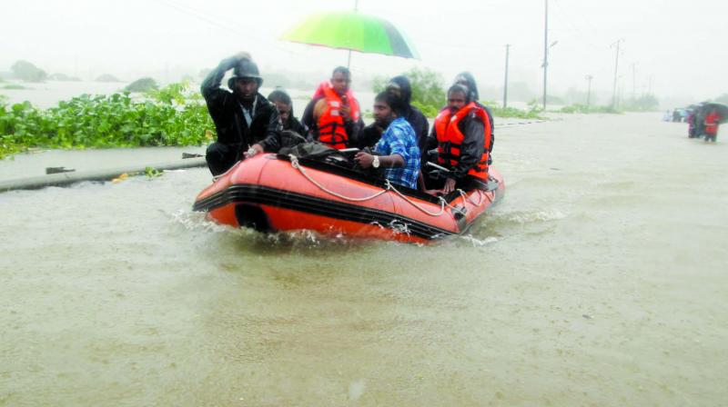 A family rafts for safety at Vasai.