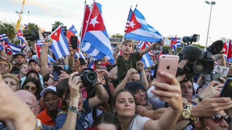 A large crowd reacts after Cuban musician Willy Chirino arrives to the Versailles Restaurant in Little Havana on Saturday, Nov. 26, 2016, following the announcement of former Cuban leader Fidel Castro's death. (Photo: AP)