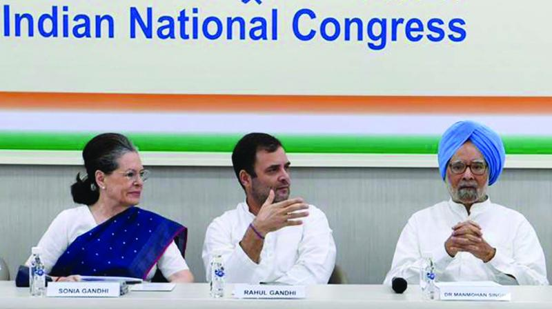 Congress leader Rahul Gandhi flanked by interim party president Sonia Gandhi and Dr Manmohan Singh during the Congress Working Committee meeting in New Delhi on Saturday. (Photo: Asian Age)