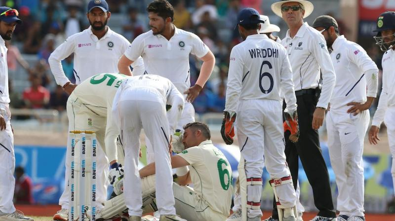 South Africa batsman Theunis de Bruyn has been named as concussion replacement for Dean Elgar, who was struck by India bowler Umesh Yadav on day three of the third Test match here on Monday. (Photo:BCCI)