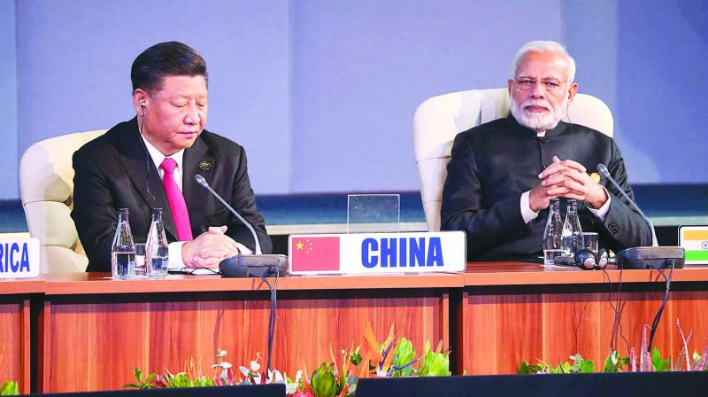 Prime Minister Narendra Modi and Chinese President Xi Jinping attend a session during the 10th Brics Summit in Johannesburg. (Photo: AFP)