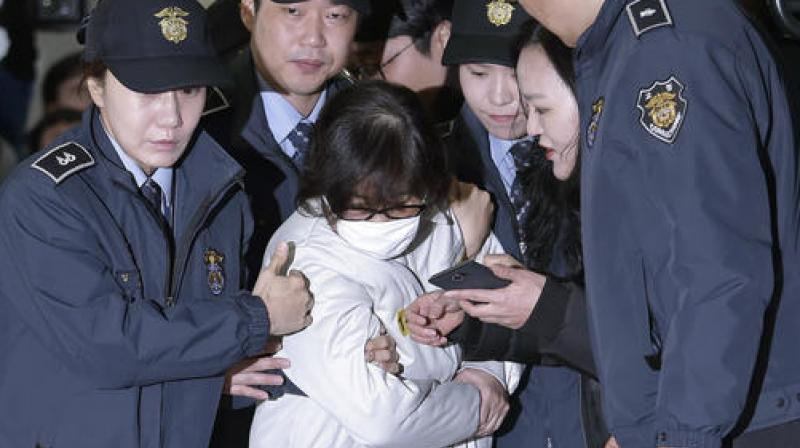 Choi Soon-sil, center, the jailed confidante of disgraced South Korean President Park Geun-hye, arrives for questioning into her suspected role in political scandal at the office of the independent counsel in Seoul. (Photo: AP)