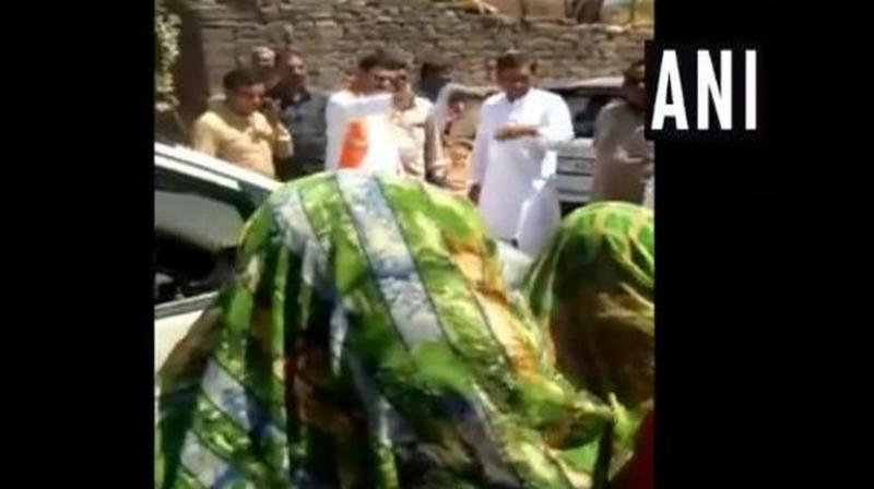 Gujarat Water Supply Minister and BJP leader Kunvarji Bavaliya questioned a group of women, who were protesting against drinking water crisis in their village, whether they voted for him or not in the last election. (Photo: ANI)
