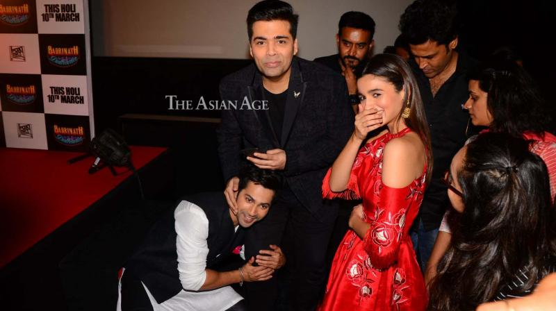 Varun Dhawan, Alia Bhatt and Karan Johar launched the trailer of their film 'Badrinath Ki Dulhania' at an entertaining event on Thursday in Mumbai. (Photo: Viral Bhayani)