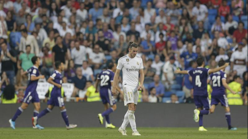 The last-minute equalizer plunged a happy Santiago Bernabeu crowd into silence and left Madrid with four points after two games. (Photo: AP)