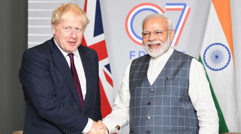 Prime Minister Narendra Modi broke the news of England's dramatic win over Australia in the ongoing Ashes series to UK PM Boris Johnson. (Photo: AFP)