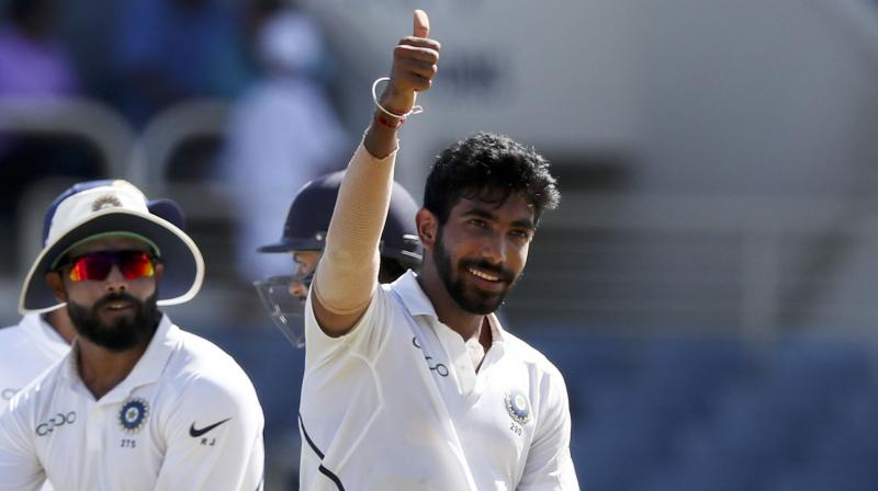 Bumrah wreaked havoc in the 9th over as he registered a hat-trick, and, with this, he became only the third Indian after Harbhajan Singh and Irfan Pathan to achieve the feat in the longest format of the game. (Photo: AP)