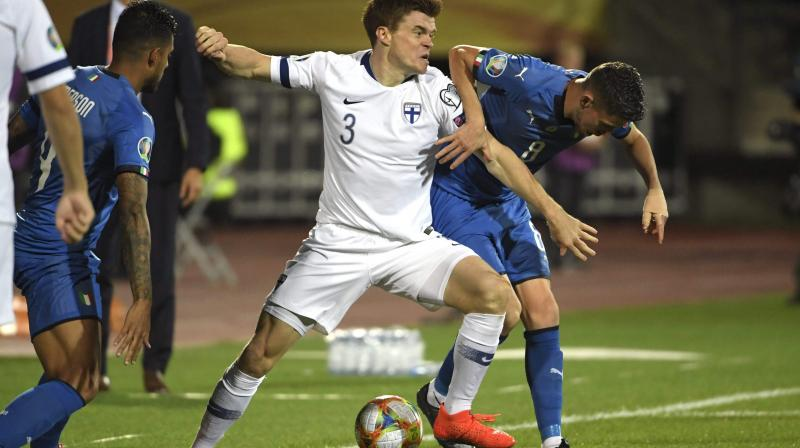 With two teams qualifying from the group, four-time world champions Italy are flying high with a maximum 18 points with four qualifying games to play. (Photo: AFP)