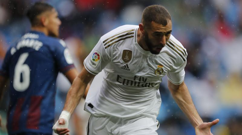 Benzema's goals came just six minutes apart in the first half at a wet Santiago Bernabeu, before Casemiro put Real 3-0 up. (Photo: AP)