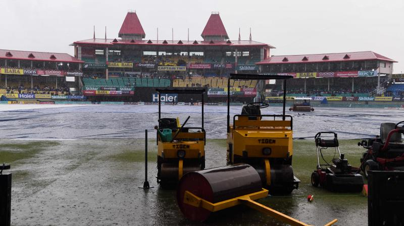 Around 30 per cent uncovered part of the ground has lots of water and water puddles were all over the outfield. (Photo: AFP)