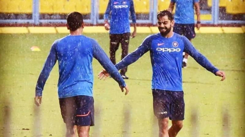 Virat Kohli on Wednesday shared a cryptic tweet related to wicket-keeper batsman MS Dhoni and accused him of stealing doubles from fielders at the boundary. (Photo: Twitter/ Virat Kohli)