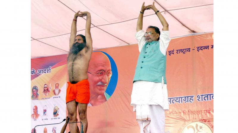 Union Agriculture Minister Radha Mohan Singh performing Yoga during a three-day Yoga event organised by Baba Ramdev, in Motihari. (Photo: PTI)