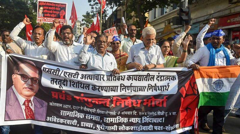 Dalit activist and supporters hold placards and raise slogans during a protest march against the alleged dilution of Scheduled Castes/Scheduled Tribes Act in Mumbai in April. (Photo: PTI)
