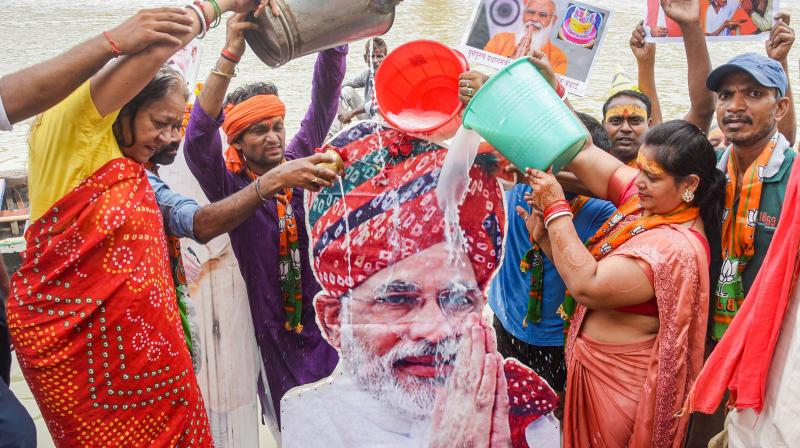 BJP supporters perform rituals on the banks of river Ganga to celebrate 71st birthday of Prime Minister Narendra Modi, in Patna, Friday, Sept. 17, 2021. (PTI Photo)