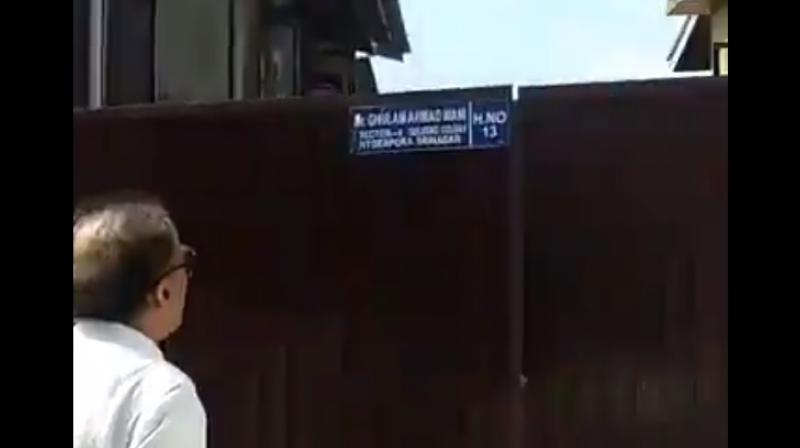 Video grab of Saifuddin Soz at the gate of the Srinagar residence of his sister. Kashmir Congress leader Soz says the visit took place under police escort. (Twitter)