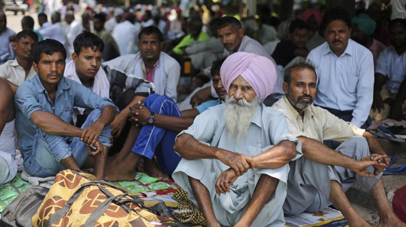 Supporters of the Dera Sacha Sauda sect squat in a public park near an Indian court in Panchkula. (Photo: PTI)