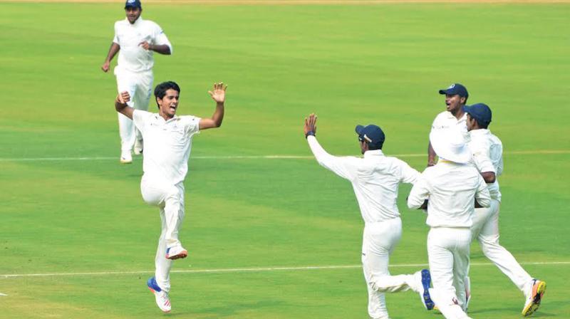Tamil Nadu pacer K. Vignesh celebrates the wicket of Karun Nair on the second day of their Ranji Trophy quarter-final. (Photo: K. Murali Krishna)