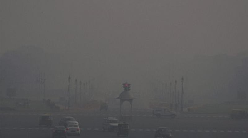 A thick layer of dense fog envelops Rajpath on a cold winter morning in New Delhi. (Photo: PTI/File)