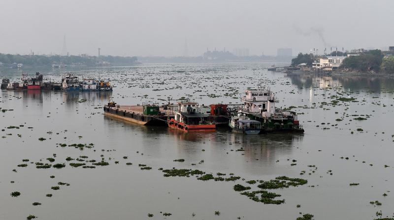 Boats are anchored on the banks of Ganga River during the nationwide lockdown in the wake of coronavirus pandemic, in Kolkata. PTI Photo