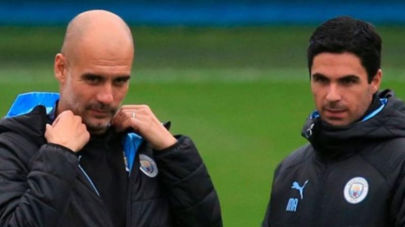 Manchester City boss Pep Guardiola said he expected a 'quick decision' on assistant Mikel Arteta's future, confirming his fellow Spaniard was in talks to take the vacant Arsenal job. (Photo:AFP)