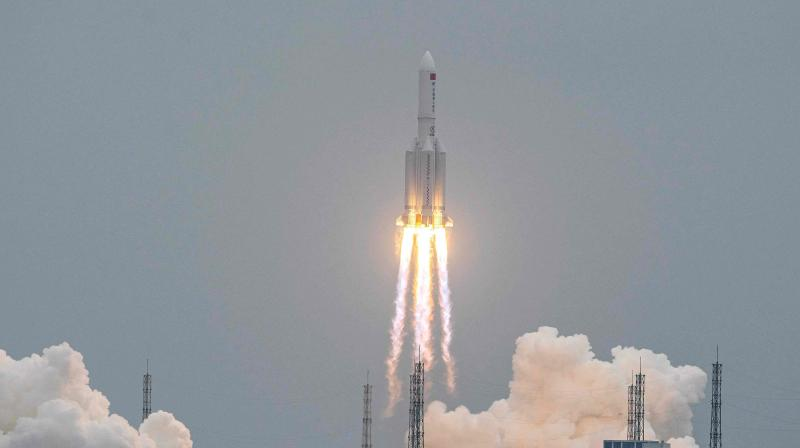 Long March 5B rocket, carrying China's Tianhe space station core module, lifting off from the Wenchang Space Launch Center in southern China's Hainan province. - A large segment of the Long March 5B rocket re-entered the Earth's atmosphere and disintegrated over the Indian Ocean, state television reported on May 9, 2021 citing the China Manned Space Engineering Office, following fevered speculation over where the 18-tonne object would come down. (AFP File)