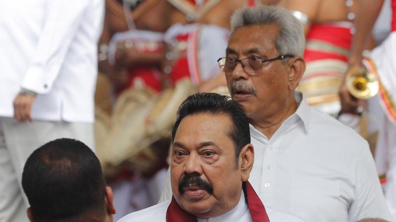In Sri Lanka, the Sinhalese perhaps chose the Rajapaksa family because they were enamored by the way prominent brothers, Mahinda and Gotabaya, ruthlessly quelled the LTTE in 2009. AP Photo